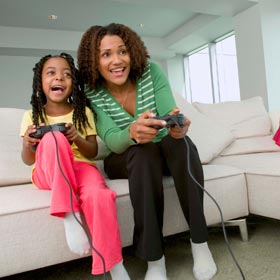 Mom gaming with daughter