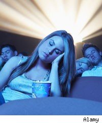 People sleeping in cinema