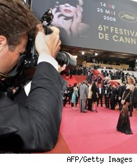 A photographer shooting Czech model Eva Herzigova as she arrives at the 61st Cannes International Film Festival on May 21, 2008 in Cannes