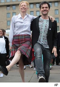 Tilda Swinton joined by writer and film maker Mark Cousins with a Flashmob dance in festival square Edinburgh