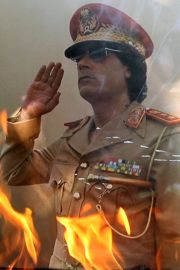 Poster of Moammar Gadhafi, torched by Libyan rebels