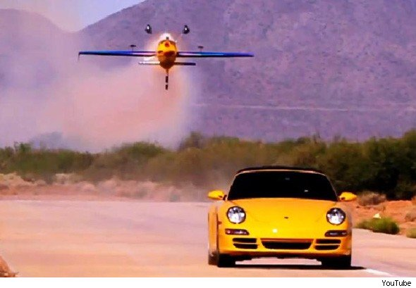 Porsche 911 and Red Bull plane