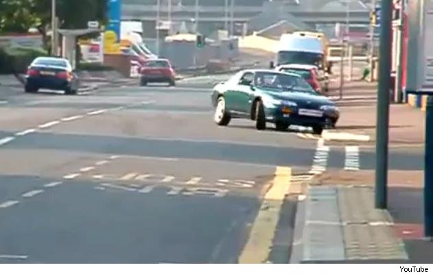 Nissan 200SX powerslides into kerb