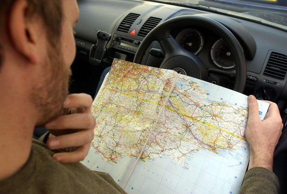 Image result for driving with a map