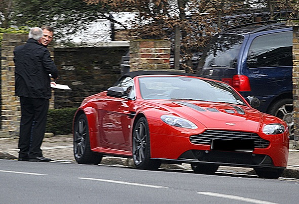 Bond star Daniel Craig test drives Aston Martin