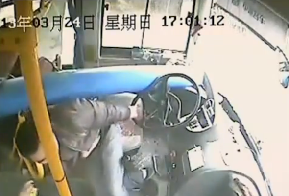 Video: Chinese bus driver takes a lamp post to the face
