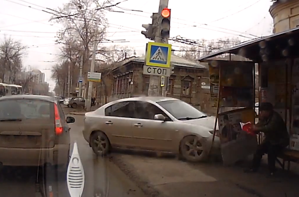 Video: Russian cop takes out bus stop