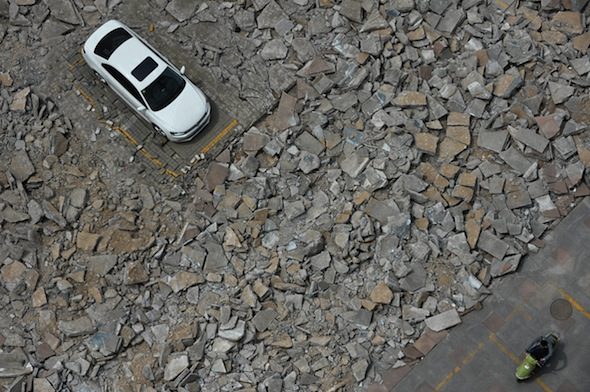 Lone vehicle stands defiant as car park is demolished around it