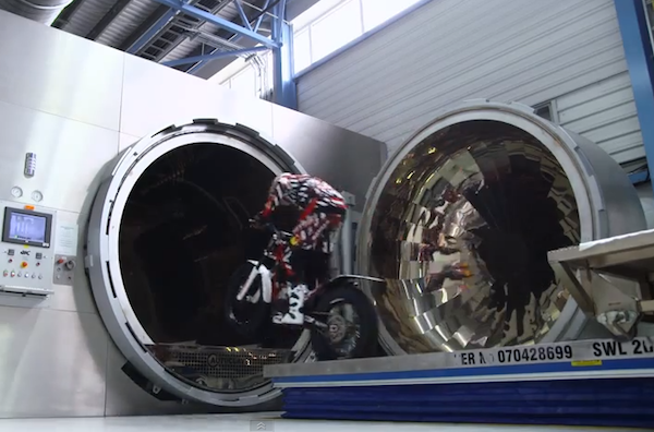 Dougie Lampkin rides through Red Bull's offices