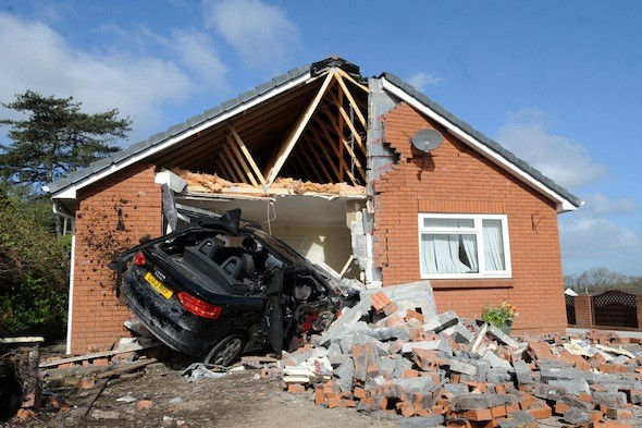 Brand new Audi smashes through bungalow wall