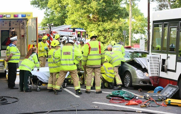 32 emergency workers free 20 stone man from car wreck