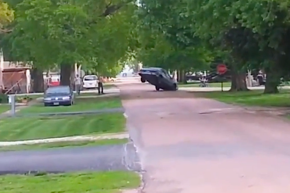 Buffoons attempt to pull down tree with rusty old car