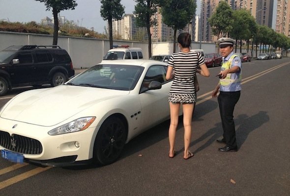 Chinese motorist parks Maserati in the middle of the road while she worked