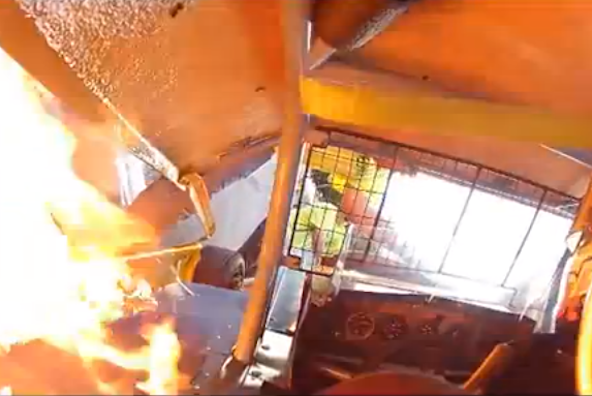 Harrowing moment speedway driver struggles to escape burning car