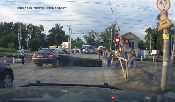BMW driver takes on ramp at level crossing - and loses