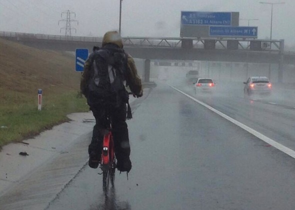 'Dummy' caught cycling down M1 in pouring rain