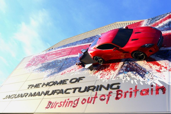 Full-size F-Type Coupé mounted on Jaguar factory wall