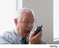 Angry man with mobile phone