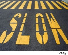 Instruction to slow down on road