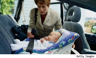 Woman and baby in car seat