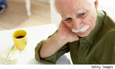 Worried man making notes memory loss Alzheimer's