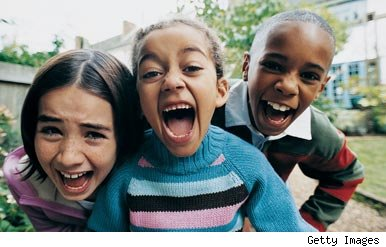 Three children laughing at half term