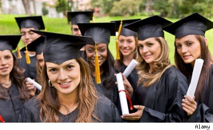 College graduates in caps and gowns hold degrees