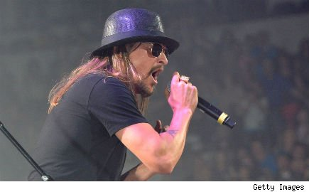 Kid Rock singing onstage