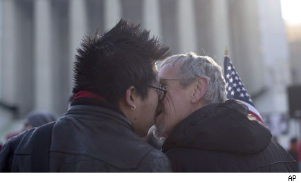 2 gay males kissing after supreme court decision