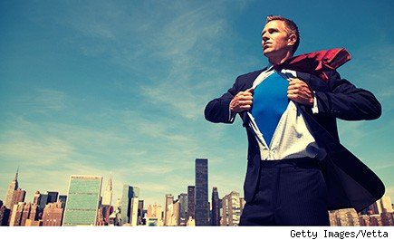 Man in suit opening his shirt to reveal superhero uniform