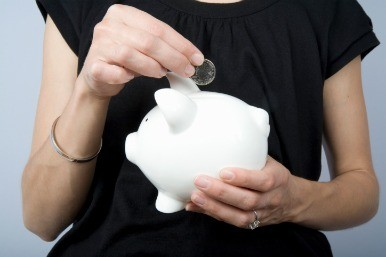 Coin being placed in piggy bank