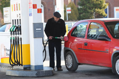 Man fills up car with fuel
