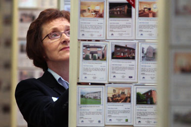Woman looking at property prices