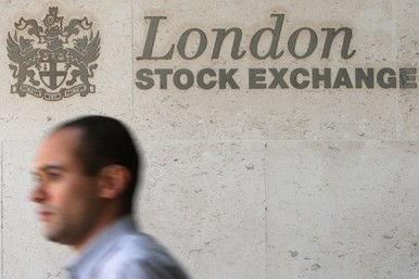 Worker passes London Stock Exchange sign