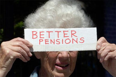 Pensioner holds sign saying Better Pensions