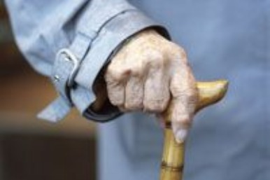 Old woman with hand on cane