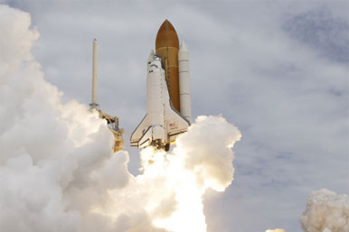 Space shuttle at lift off