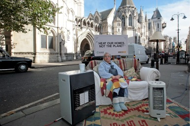 Older person with heaters on street