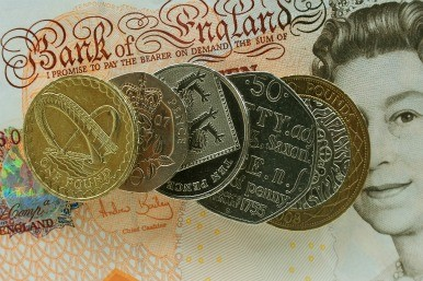 Coins on a 10 pound note