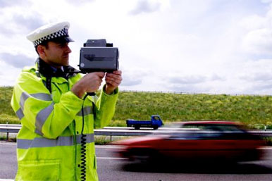 police officer with speed camera gun