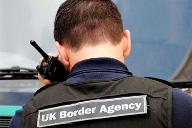UK border Agency guard using radio