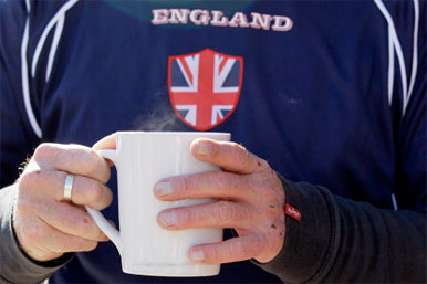England fan drinking mug of tea
