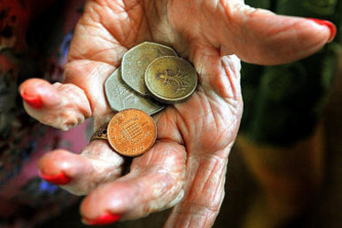 elderly lady with coins