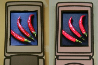Three chillis on a mobile phone