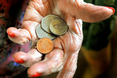 elderly lady's hand holding coins