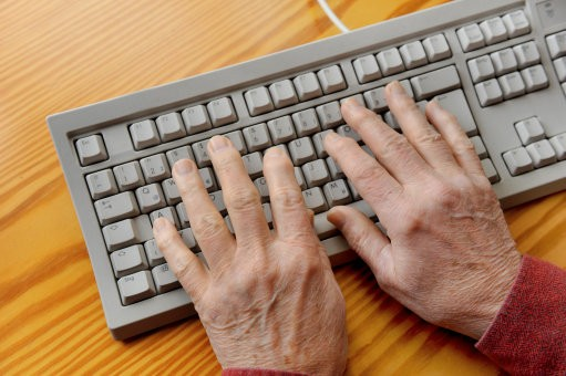 Elderly hands on keyboard