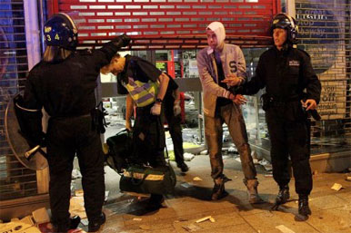 rioter arrested outside shop with shutter