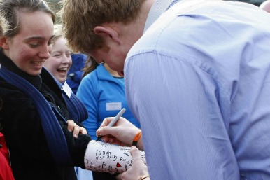 Prince Harry signs a plaster cast