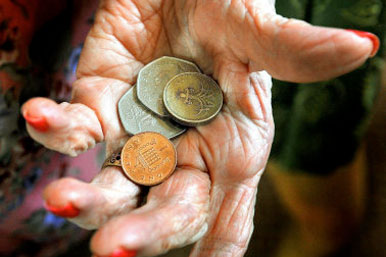 elderly hand with coins