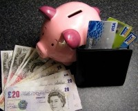 Piggybank with cards and money